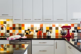 """This Century-Old Bungalow Is an Eternal Work-in-Progress - Photo 2 of 4 - The backsplash is an exuberant mix of colorful tile. """"We used a randomizer algorithm to design the multi-colored non-pattern,"""" says Lori."""