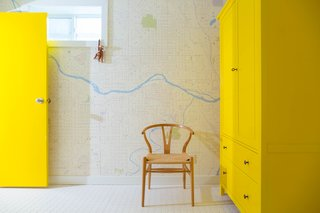 25 Bold Ways to Decorate with Yellow - Photo 24 of 25 - While addressing plumbing problems, the residents took time to spruce up the bathrooms, adding new tile, fixtures, and, in one, a cheery yellow cabinet.