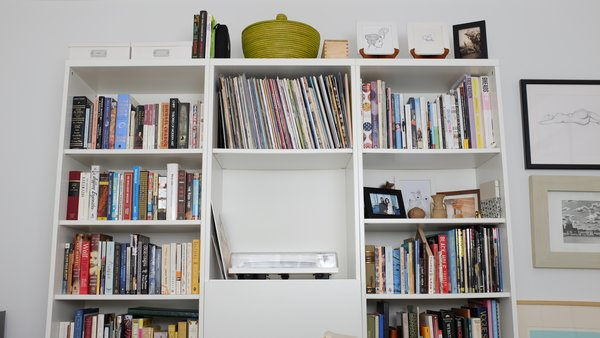 An IKEA shelf in the guest room displays an Orbit Turntable by U-Turn.