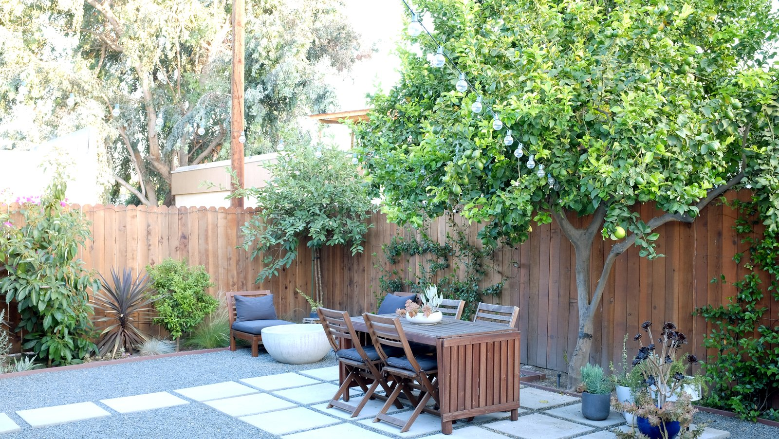 The house was freshly renovated when the residents bought the house in 2013; they redid the backyard themselves. The Bowl fire pit is by Potted. The L.A. Home of Song Exploder's Hrishikesh Hirway Is Barely Larger  Than a Music Box - Photo 7 of 7