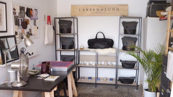 Fashion designer Lindsey Lund Mortensen's half of the studio showcases some of her creations as well as an inspiration board.