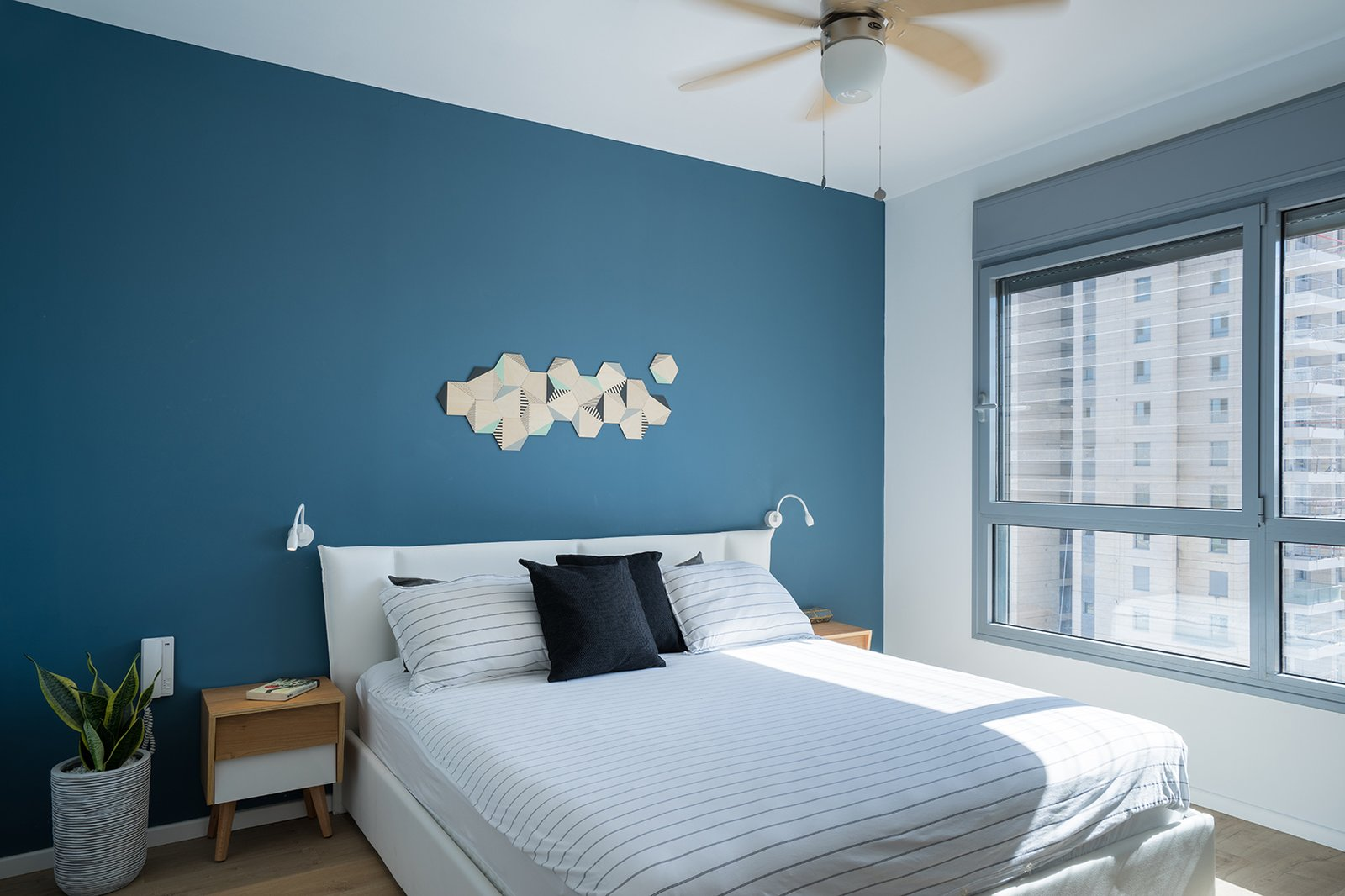 Dollops of black define the open-plan area, but in the bedrooms, brighter colors prevail. Tagged: Bedroom, Bed, and Night Stands.  Photo 3 of 4 in A Riotous Makeover for a Generic  High-Rise Home