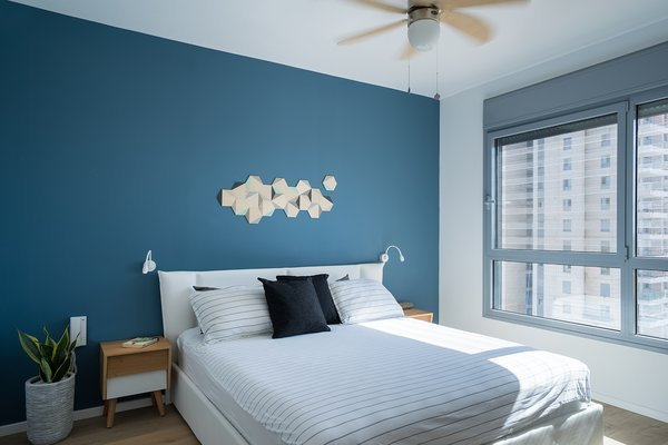 Dollops of black define the open-plan area, but in the bedrooms, brighter colors prevail.