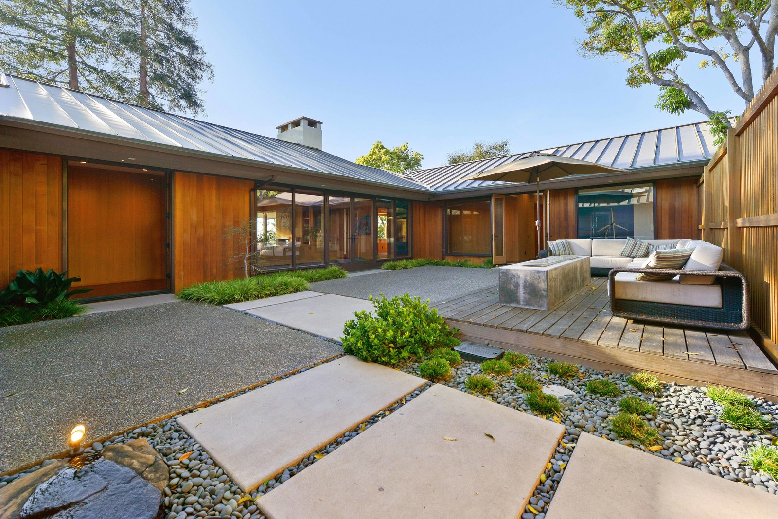 Shannon Bloemker's hillside home in Piedmont, California, is arranged in a C-shape with protected courtyards. A Quintessential Midcentury Home Goes LEED Platinum - Photo 2 of 6