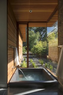 Channeling Midcentury Modern in Northern California - Photo 5 of 7 - An onsen, or Japanese soaking tub, with a private garden abuts the master suite.