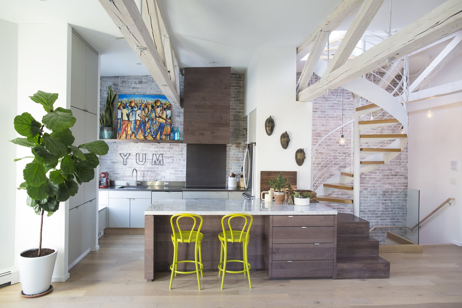 Tagged: Kitchen, Light Hardwood Floor, Marble Counter, and Wood Cabinet.  Photo 1 of 5 in This Modern Boston Renovation Expertly Mixes in Colorful Craft Finds