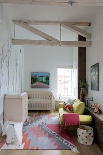 20 Cool Cribs for the Modern Baby - Photo 3 of 20 - For the couple, who are expecting, adding a nursery was a key component of the renovation. The home's historic trusses were lightly sanded and whitewashed.