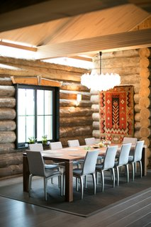 Winter Is Coming. Why Not Buy This Log Cabin–Style Villa in Finland? - Photo 4 of 7 - A traditional tapestry and other textile accents warm the home. The chandelier is by Kalmer.