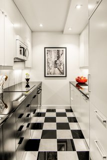 After Sandy, an NYC Designer Rehabs His Ruined Apartment—and Lends Neighbors a Hand with Theirs - Photo 2 of 4 - The 650-square-foot apartment has a galley kitchen with checkered black-and-white tile.