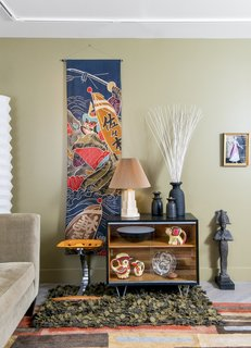 After Sandy, an NYC Designer Rehabs His Ruined Apartment—and Lends Neighbors a Hand with Theirs - Photo 3 of 4 - A living room vignette includes a 1950s batik Boy's Day banner from Japan, Czech pottery, and a framed costume presentation from the estate of late opera diva Beverly Sills.