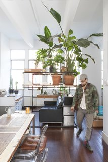 Huy Bui's Brooklyn Loft Is Like a Self-Contained Jungle - Photo 2 of 4 - The dining table is made of a composite of different woods sourced from various projects.