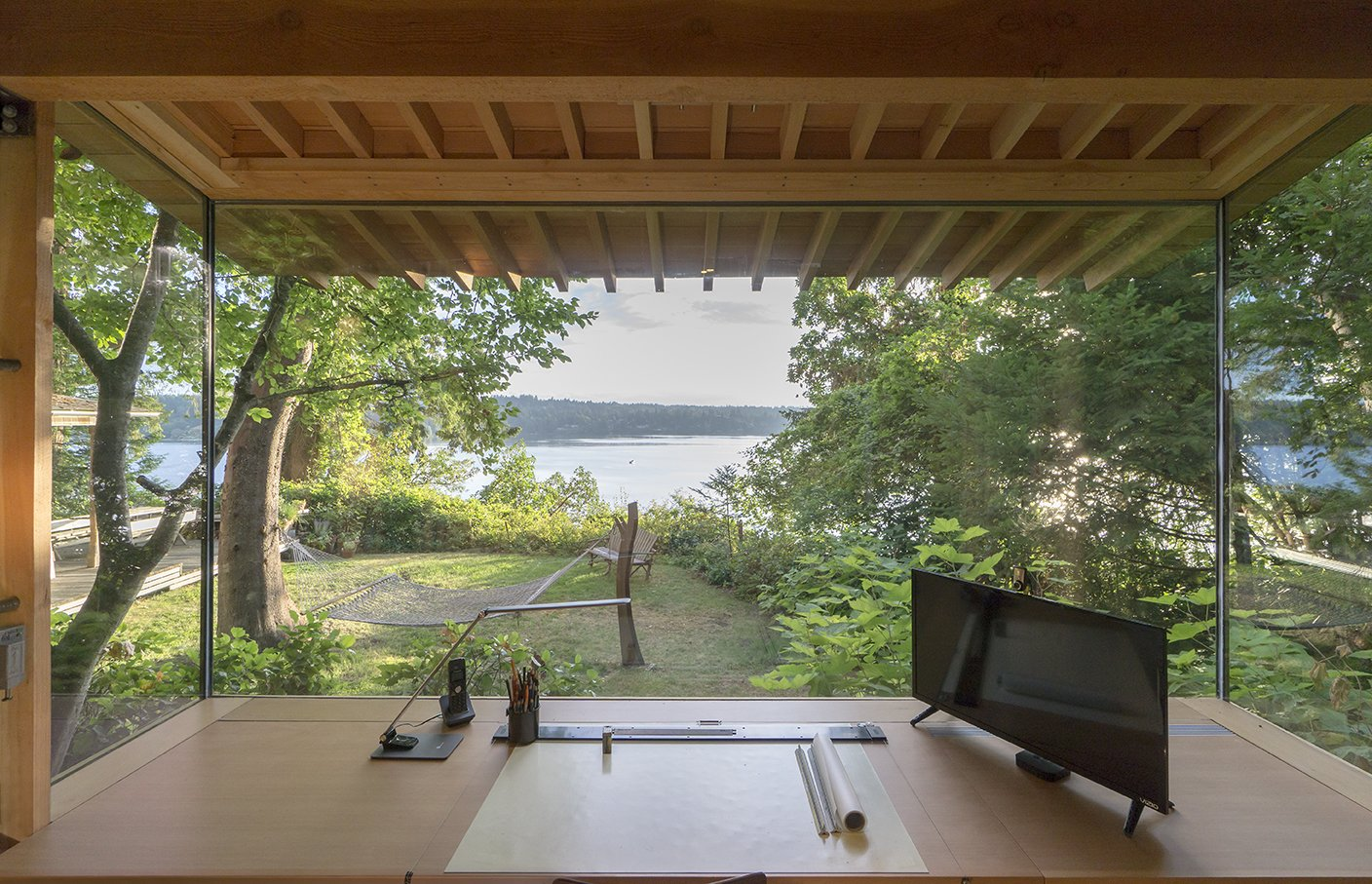 The workstation and the cabinets are by Korben Mathis Woodworking; the desk lamp is  from TaoTronics. Tagged: Office, Desk, Lamps, Craft Room, and Study.  Cutler Studio/Bunkhouse by Luke Hopping from Family Matters