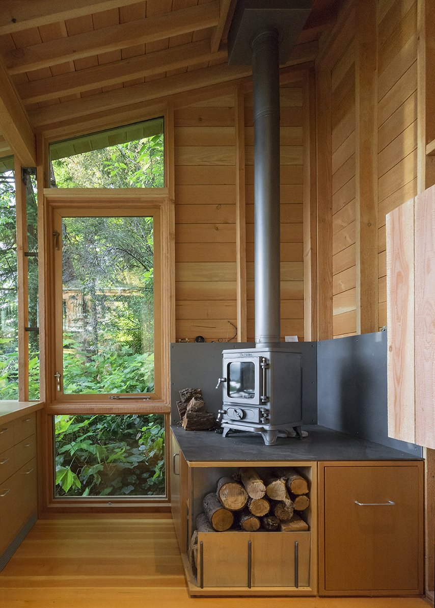 While the space is heavily insulated, with strong solar gain, a cast-iron stove from Salamander Stoves provides extra warmth on cool days. Tagged: Shed & Studio, Living Space, and Den.  Cutler Studio/Bunkhouse by Luke Hopping from Family Matters