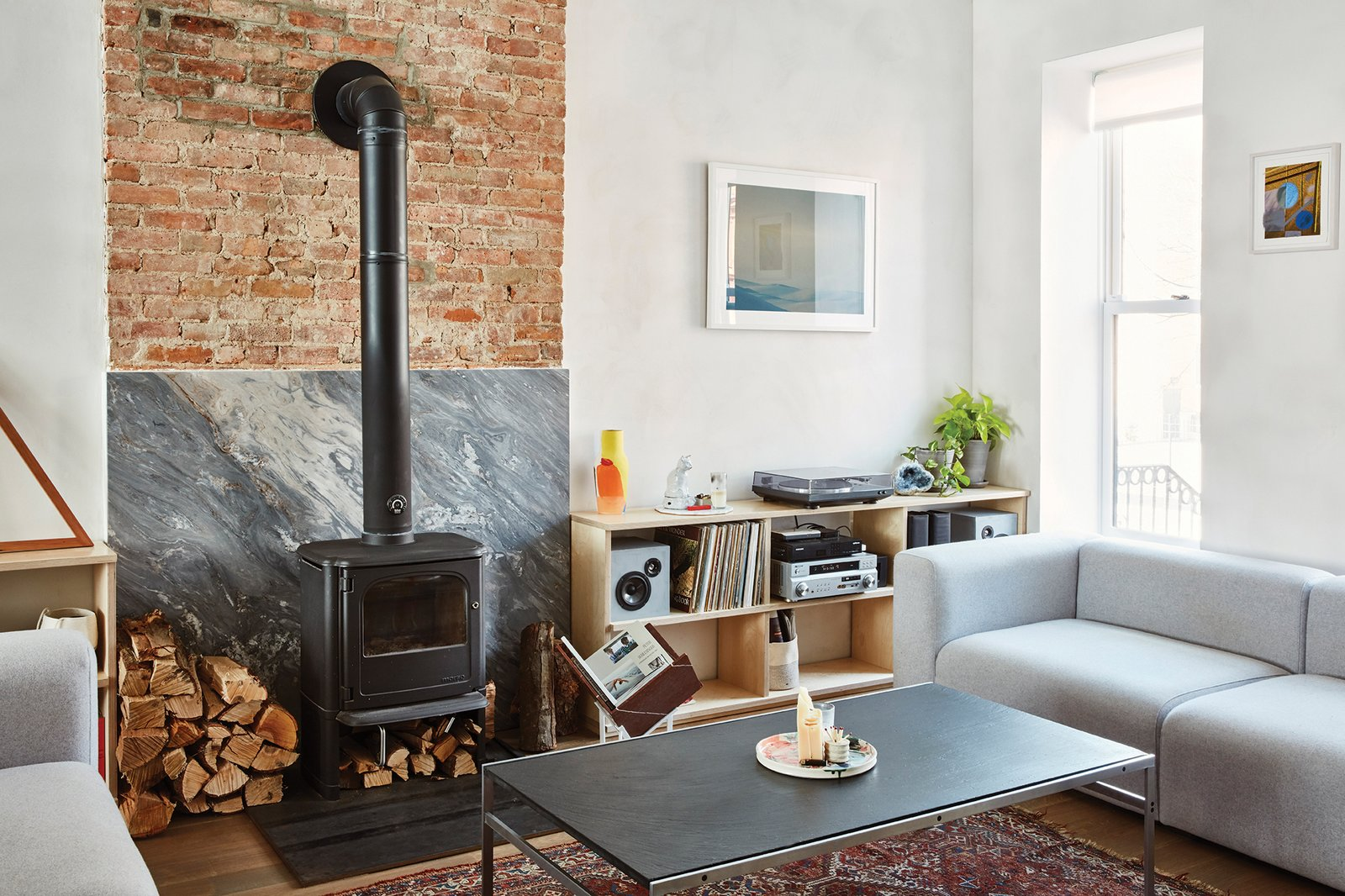 The first floor holds the living room, which includes a Morsø 3440 wood-burning stove and a pair of Mags sofas by HAY.