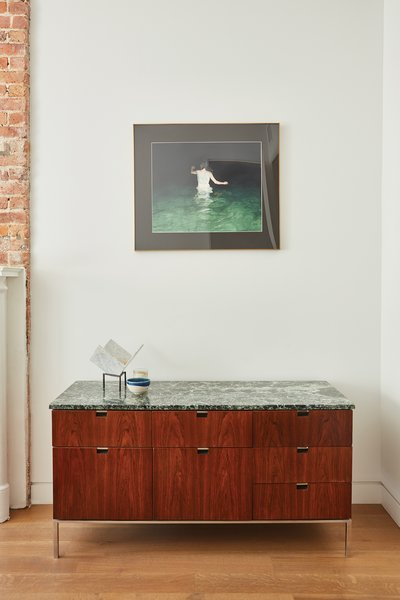 The console is vintage Florence Knoll. Photo 8 of Bedford-Stuyvesant Brownstone modern home