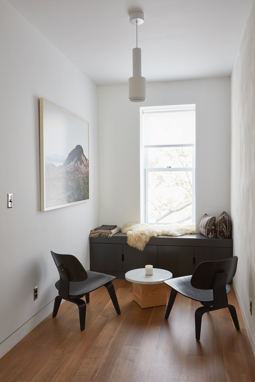 """In an eighteen-foot-wide brownstone, there's only so much you can do. But we wanted  it to feel fresh,"" Keith Burns, architect and resident Tagged: Living Room, Chair, Storage, Pendant Lighting, and Medium Hardwood Floor.  Photo 9 of 16 in Forever Changes"