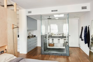 "Forever Changes - Photo 10 of 16 - One of the boldest moves was the glass-encased shower inside the revamped master bedroom. ""Obviously, building that shower was not a cost-saving option,"" says Keith, ""but we used green slate, which is not super expensive, either."" The Architec sinks are from Duravit."