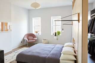 "Forever Changes - Photo 12 of 16 - ""Everything in the bedroom is built in, including the bed,"" adds Keith, who commissioned Hub Woodworks to mill this key feature. Andrew Neyer Crane lights flank the bed, an Akari pendant by Isamu Noguchi hangs overhead, and a Womb chair by Eero Saarinen for Knoll, covered in Cassia fabric from Designers Guild, sits in the corner."