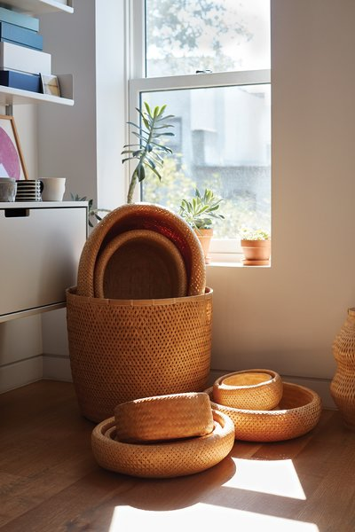 A Vitsœ shelving system and a  collection of bamboo baskets made in Vietnam occupy a sunny corner in the office that Lauren and Keith share on the top floor. Photo 14 of Bedford-Stuyvesant Brownstone modern home