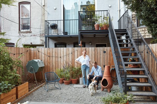 It feeds their backyard garden, which also features permeable paving rocks, a composting  bin, and a surrounding fence made  of knotty Western red cedar.