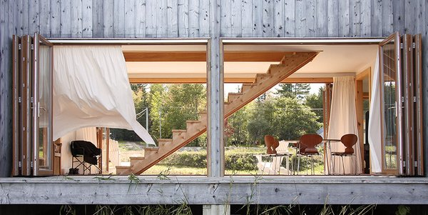 Agricultural buildings inspire a remote getaway in eastern Canada. Photo  of House R modern home