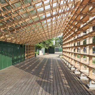Architecture Remix - Photo 6 of 8 - The design works around an existing shipping container and deck. By folding the roof along the edge of the container, Hou de Sousa was able to optimize materials and achieve the desired structural load distribution.