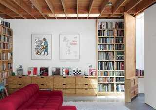 12 Functional Modern Home Libraries - Photo 10 of 12 - After a tree falls in Santa Monica, a garage is reborn as a 600-square-foot family gathering. When Libby May and Eoghan Mahony purchased a 1950s post-and-beam house in Los Angeles' Santa Monica Canyon, they envisioned someday transforming the garage and adjoining workshop into livable space, with an office for each of them and a family room they could share with their sons.
