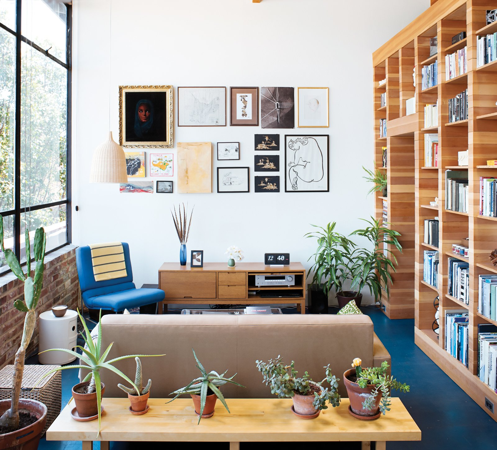 Persistence paid off for this California couple who worked overtime for two years to tackle their all-in-one loft renovation. 30+ Modern Homes With Libraries by Matthew Keeshin