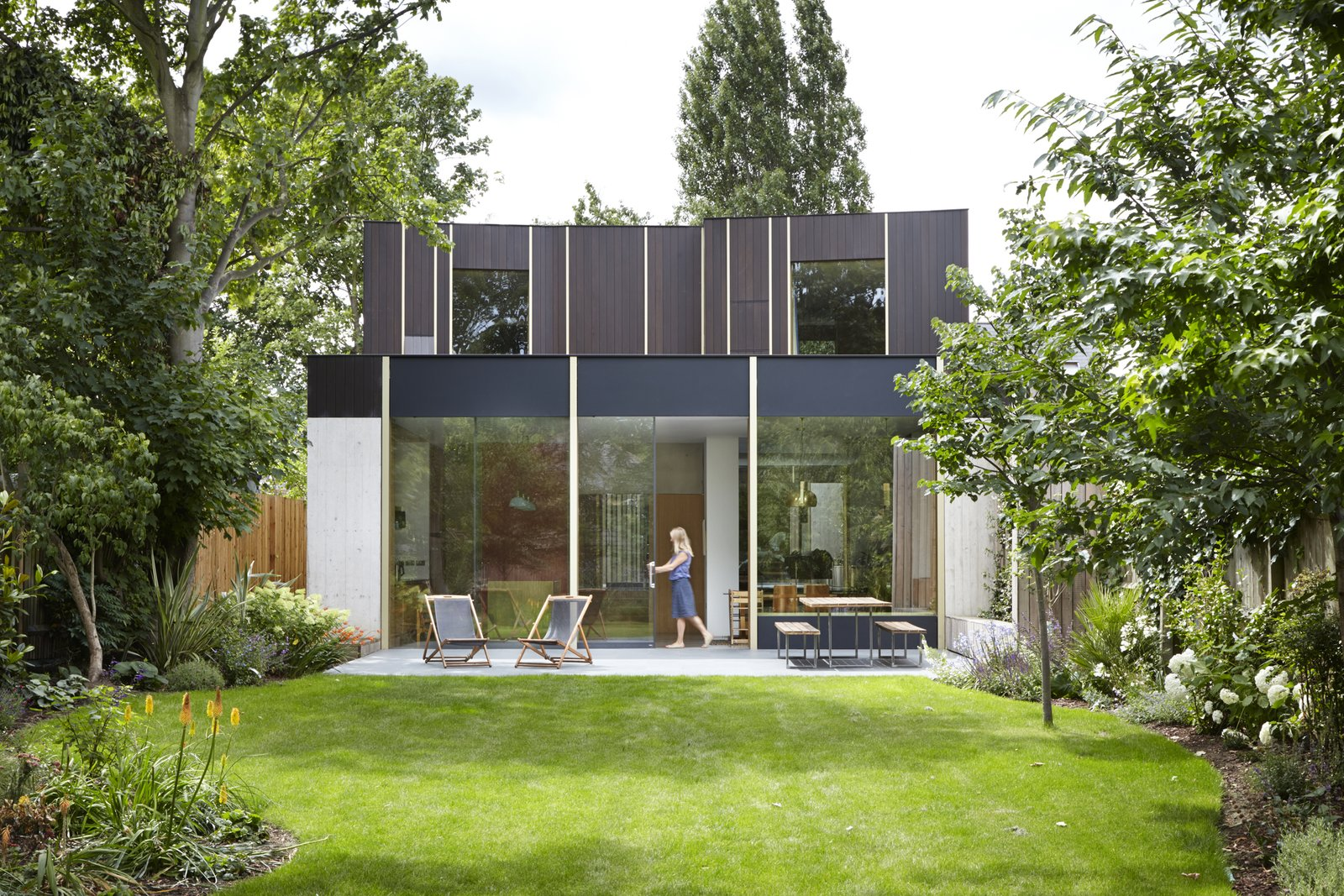Landscaping was designed by Gardenia Gardens.  Photo 3 of 9 in This Modern Courtyard Home Celebrates a 100-Year-Old Tree