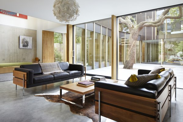The sofas are designed by Robin Day for Habitat. The walnut frame nicely contrasts with the soft leather cushions.