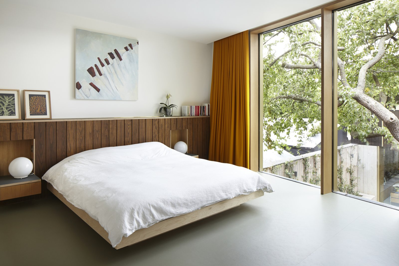 Edgley Design designed the beds and headboards in the bedrooms. Just one of the several bespoke details that the firm included in the home.  Photo 9 of 9 in This Modern Courtyard Home Celebrates a 100-Year-Old Tree
