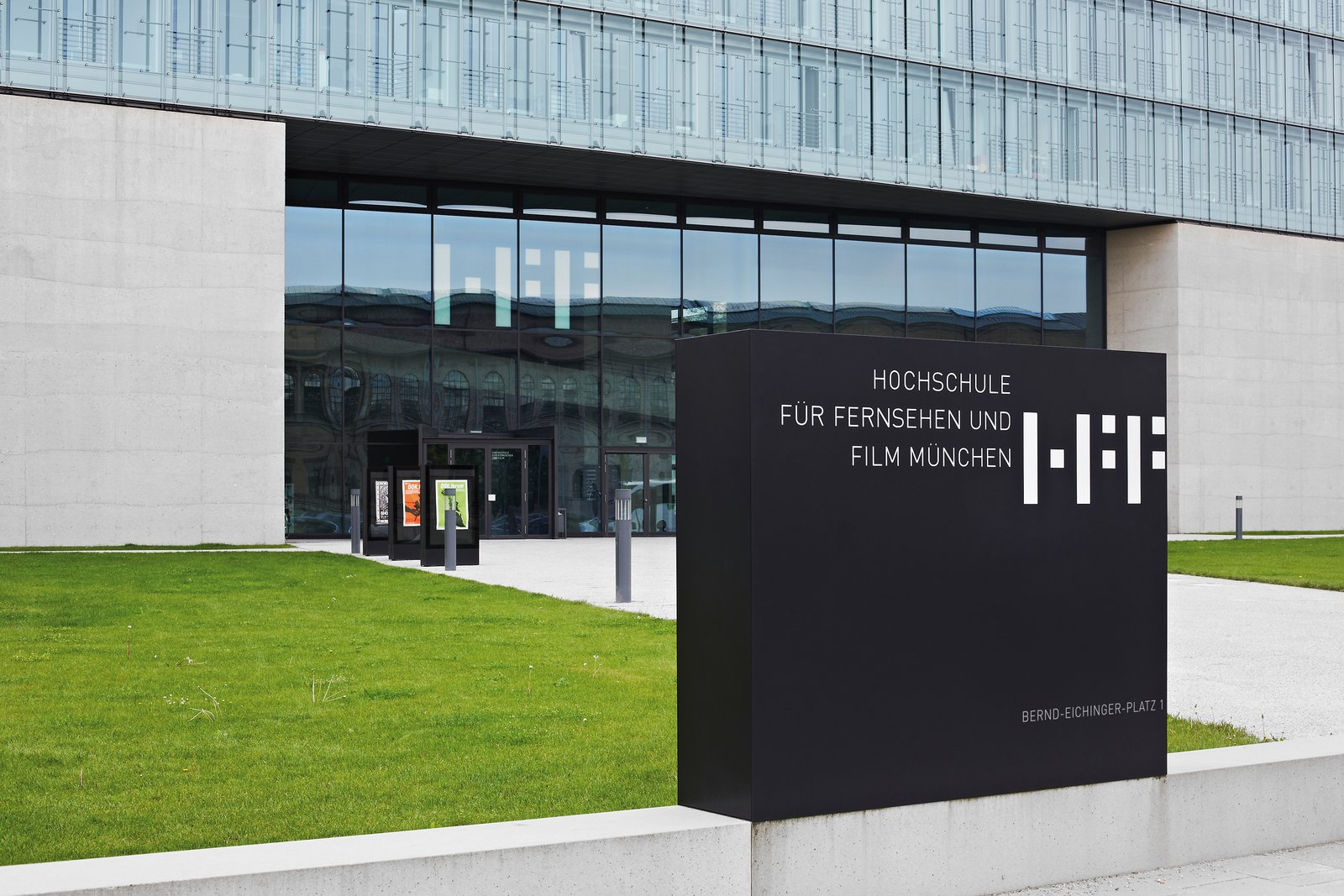 University of Television and Film Munich: To ensure easy orientation, the university's logo and important information were applied, almost like projections, directly onto the concrete and glass facades for high visibility.  Way-Finding Systems by Rob Hewitt