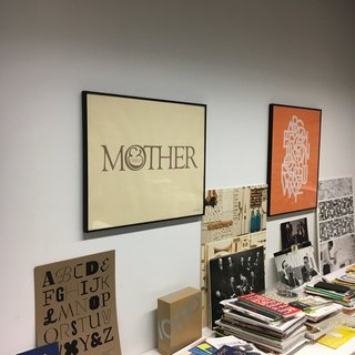 "New York's Hidden  Graphic Design Gem - Photo 3 of 6 - Shot taken within the Herb Lubalin Study Center the original ""Mother & Child"" logo, to the right ""ABCDEFG..."" the alphabet set in Avant Garde Gothic, designed by Herb Lubalin and Tom Carnase. One of many examples of typically Lubalin-esquen arrangement of interlocking and overlapping letterforms. 1974"