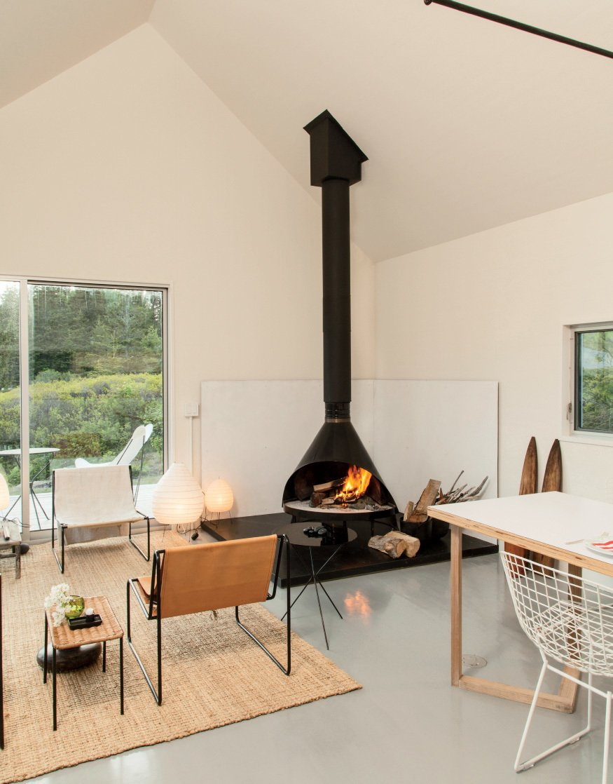 Photo by Caroll Taveras   97+ Modern Fireplace Ideas by Dwell from Scandinavian Inspired Design