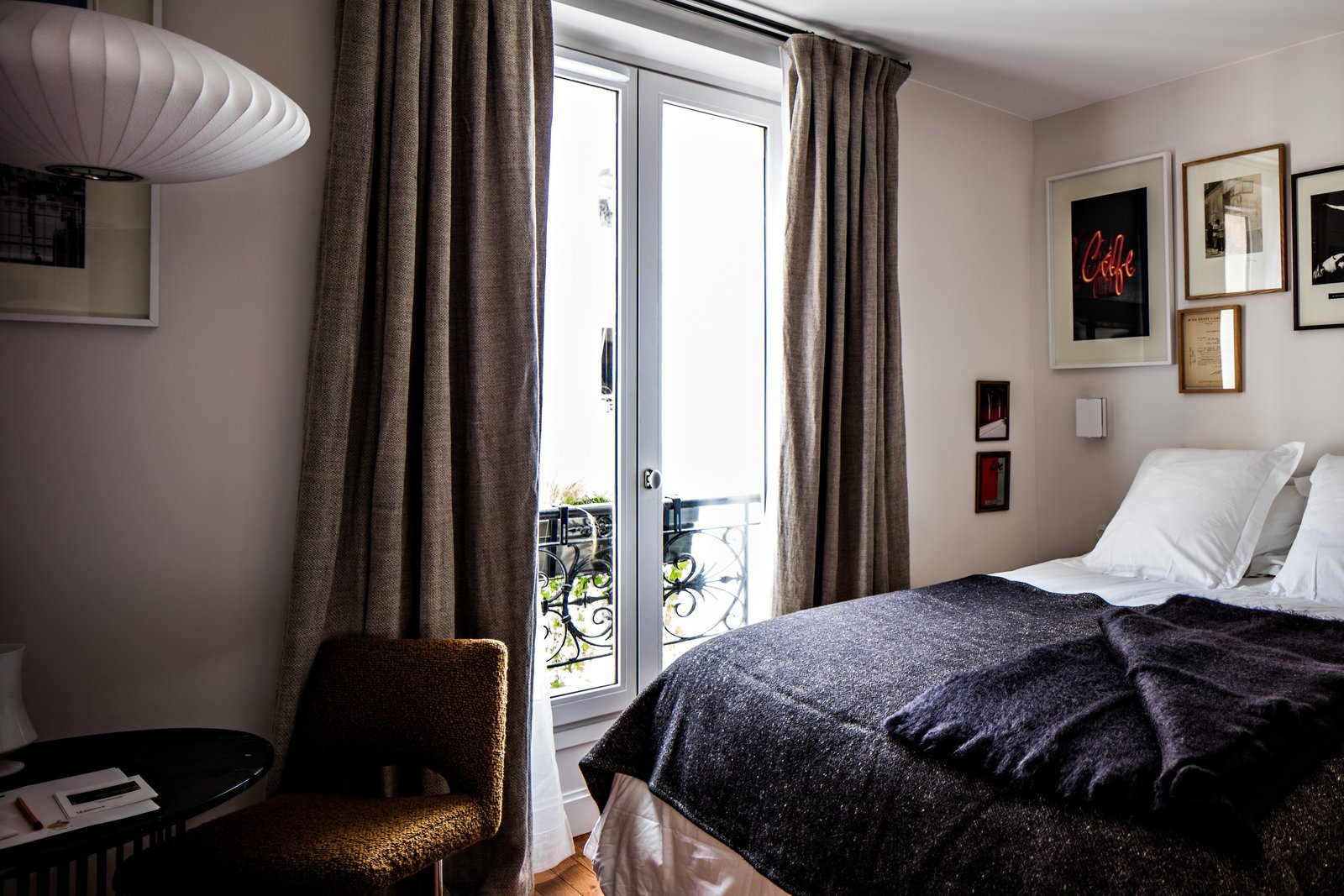Rooms are simple and comfortable, each with its own personality. Objects in both the public spaces and hotel rooms have been collected and curated by local artisans, designers, and shopkeepers.  Photo 4 of 8 in Collaboration Reigns  Over This Parisian Neighborhood Hotel