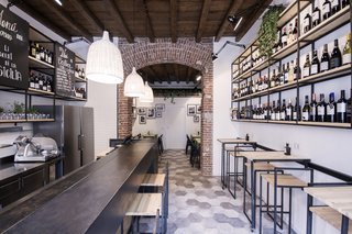 Bringing a Taste of  Sicily to Milan - Photo 1 of 5 - Studio DiDeA maximizes the use of the restaurant's limited square footage by utilizing all aspects of the space for storage, dining, drinking, or display purposes.