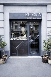 Bringing a Taste of  Sicily to Milan - Photo 5 of 5 - Previously a tailor's shop located in the heart of Milan, Muddica has been converted into a restaurant, bar, and Sicilian deli.