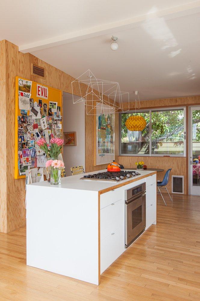 #SwanHouse #renovation #remodel #1950s #modern #interior #inside #kitchen #island #stove #lighting #color #windows #2013 #LosAngeles #California #BarbaraBestor