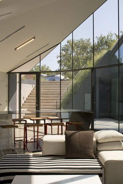 #EdgelandHouse #residence #modern #sunken #pithouse #windows #seating #staircase #interiors #inside #indoors #structure #BercyChenStudio Photo  of Edgeland House modern home