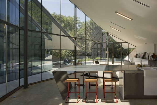#EdgelandHouse #residence #modern #sunken #pithouse #interiors #windows #glass #lighting #counter #barstools #inside #indoors #structure #BercyChenStudio Photo 9 of Edgeland House modern home