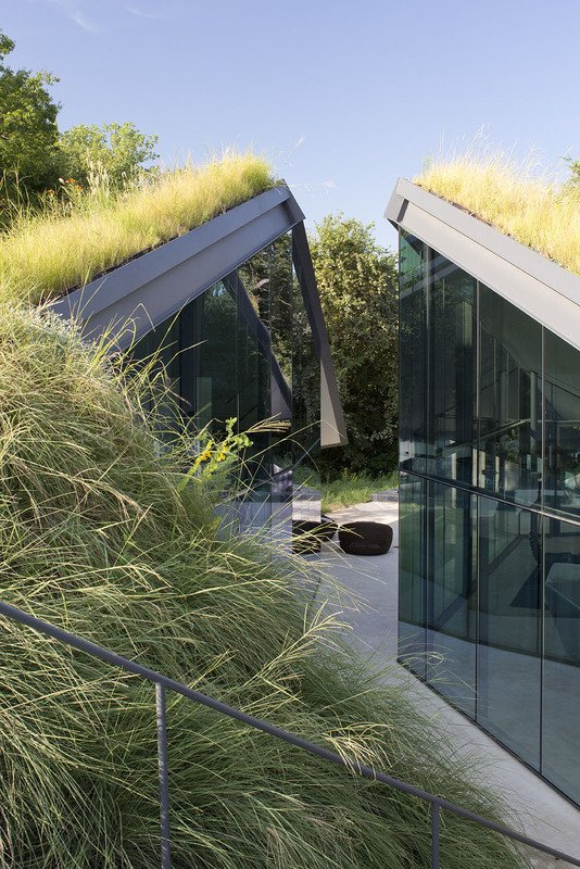 #EdgelandHouse #residence #modern #sunken #pithouse #exterior #dynamic #glass #windows #geometric #outside #outdoors #structure #BercyChenStudio  Edgeland House by Bercy Chen Studio