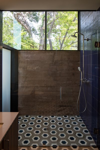 Modern home with bath room, tile counter, concrete counter, open shower, and ceramic tile floor. Photo 10 of Tetra House
