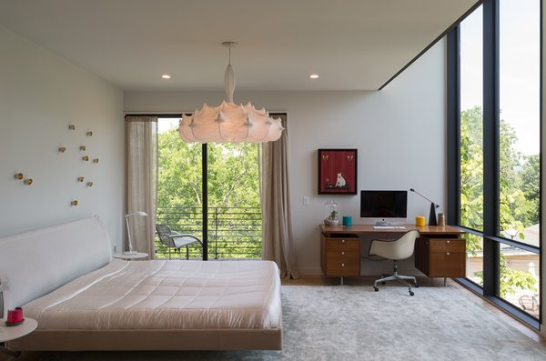 Modern home with bedroom, bed, and pendant lighting. Photo 12 of Tetra House