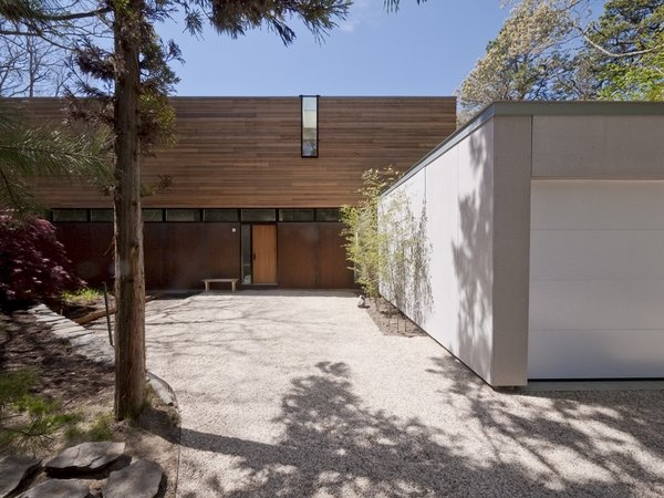 #LightboxWainscott #structure #form #stackedboxes #modern #exterior #outside #outdoors #landscape #entryway #garage #JaredDellavalle #BernheimerArchitects Photo 7 of Lightbox Wainscott modern home