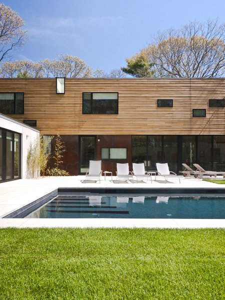 #LightboxWainscott #structure #form #stackedboxes #modern #exterior #outside #outdoors #landscape #seating #pool #JaredDellavalle #BernheimerArchitects Photo 2 of Lightbox Wainscott modern home