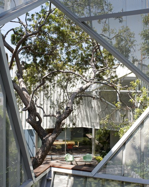 #outside #exterior #outdoor #geometry #Eames #rockingchair #tree #landscape #color #aluminum #metal #eco #green #sustainable #Venice #California #KevinDalyArchitects Photo 4 of Venice Residence modern home
