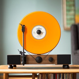 How about this upright record player to start a conversation? Or to brighten a living room with sound, color and style.