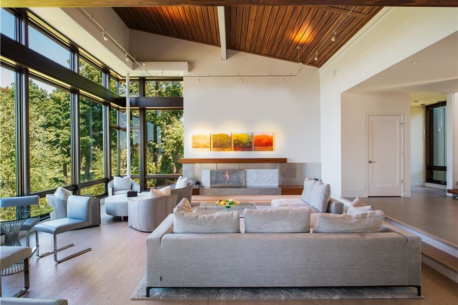 Photo courtesy of Holmes, King, Kallquist & Associates provided by Marvin Windows and Doors; project submitted to 2017 Marvin Architects Challenge Tagged: Living Room, Chair, Sofa, Coffee Tables, and Ceiling Lighting.  Modern Waterfront Residence by Marvin Windows and Doors