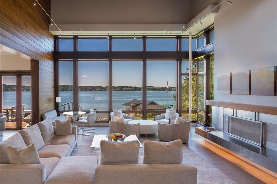 Photo courtesy of Holmes, King, Kallquist & Associates provided by Marvin Windows and Doors; project submitted to 2017 Marvin Architects Challenge Tagged: Living Room, Sectional, Chair, and Ceiling Lighting. Modern Waterfront Residence by Marvin Windows and Doors