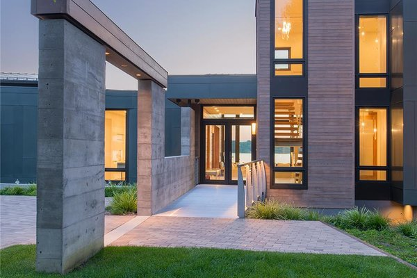 Photo courtesy of Holmes, King, Kallquist & Associates provided by Marvin Windows and Doors; project submitted to 2017 Marvin Architects Challenge Tagged: Outdoor, Front Yard, Grass, and Shrubs.  Modern Waterfront Residence by Marvin Windows and Doors